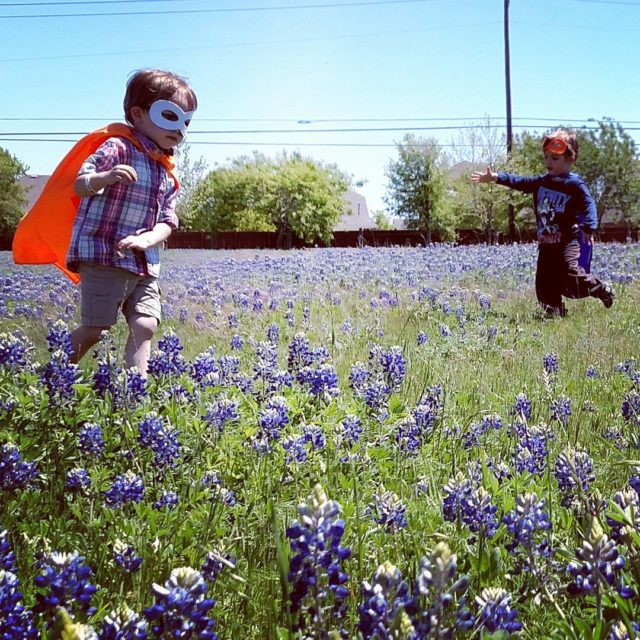 Superheros in a Field of Blue